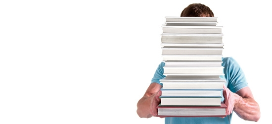 Man carrying pile of books