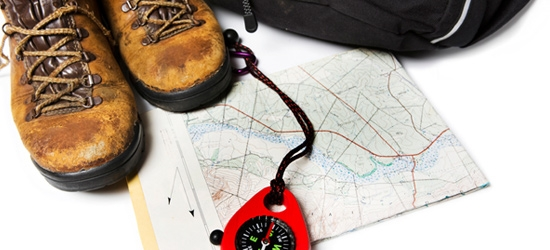 Walking boots, map and compass